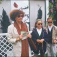 Marlène Jobert avec ses deux filles Eva et Joy à Roland Garros en 1990