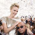 Charlize Theron et Jean-Baptiste Mondino au défilé Christian Dior, à Paris le 7 juillet 2014.