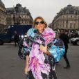 Anna Dello Russo arrive à l'Opéra de Paris pour assister au défilé Stella McCartney automne-hiver 2015-2016. Paris, le 9 mars 2015.