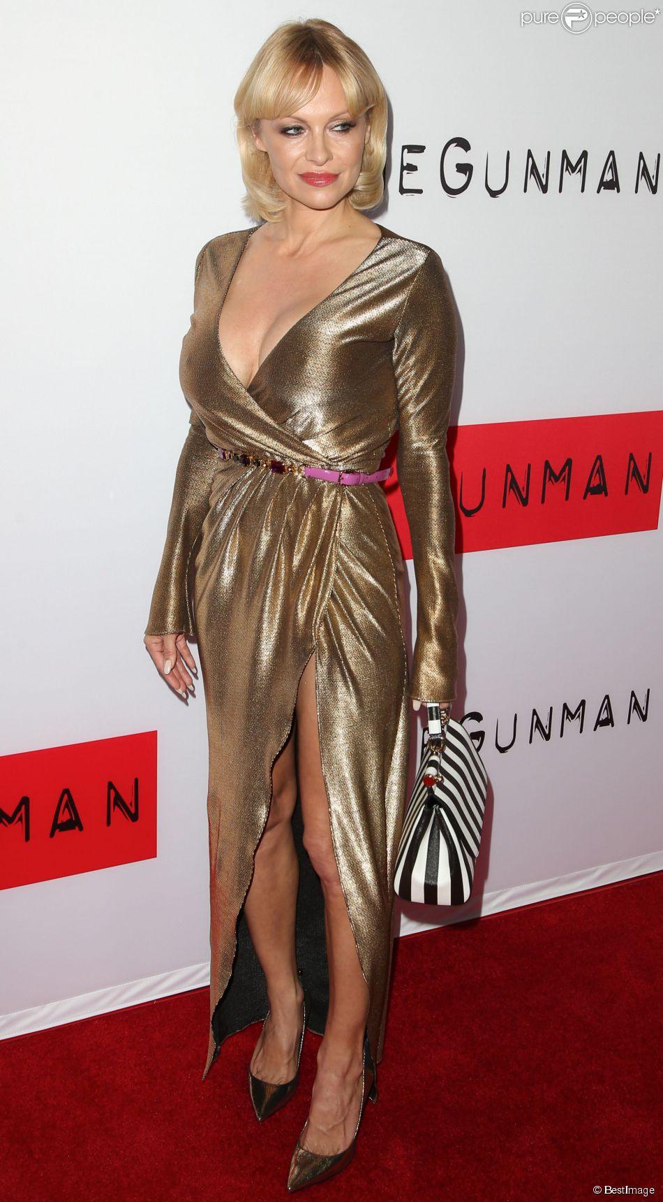 """Pamela Anderson à la première du film """" The Gunman """" Los Angeles, le 12 Mars 2015"""