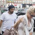 Pamela Anderson et son mari Rick Salomon arrivent à Roskilde sur l'île de Seeland, le 28 juillet 2014. Pamela Anderson est préoccupée par le sort des dauphins victimes de braconnage et elle donnera une conférence de presse, le 29 juillet, sur le sujet pour alerter le public et les médias sur l'urgence de la situation