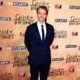 """Alfie Allen à l'avant-première mondiale de la saison 5 de """"Game of Thrones"""" organisée à Londres, le 18 mars 2015."""