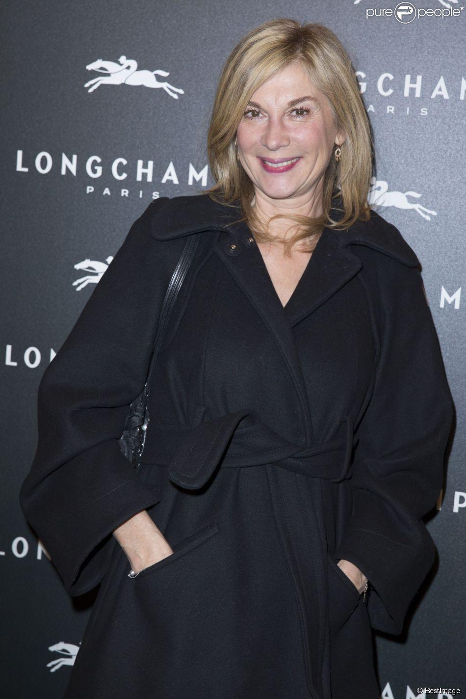 Michèle Laroque - Ouverture de la boutique Longchamp sur les Champs-Elysées à Paris le 4 décembre 2014.