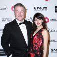 """Alec Baldwin et sa femme Hilaria Thomas, enceinte à la Soirée """"Elton John AIDS Foundation Oscar Party"""" 2015 à West Hollywood, le 22 février 2015."""