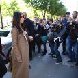 Kanye West et Kim Kardashian arrivent au Montaigne Market, sur l'avenue Montaigne. Paris, le 14 avril 2015.