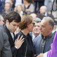 Cendrine Dominguez avec son fils Léo, Jean-Louis Borloo, le frère de Patrice Dominguez - Sorties des obsèques de Patrice Dominguez en la basilique Sainte Clotilde à Paris. Le 16 avril 2015
