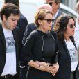 Cendrine Dominguez et ses enfants lors des obsèques de son époux Patrice Dominguez en la basilique Sainte-Clotilde à Paris le 15 avril 2015