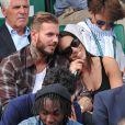 M. Pokora et sa nouvelle compagne Scarlett Baya assistent aux Internationaux de France de tennis de Roland-Garros à Paris le 2 juin 2014.