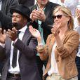 Sylvain Wiltord et Michèle Laroque - People dans les tribunes lors du tournoi de tennis de Roland Garros à Paris le 29 mai 2015