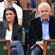 Patrick Poivre d'Arvor et une amie - People dans les tribunes lors du tournoi de tennis de Roland Garros à Paris le 29 mai 2015.
