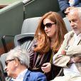 Francis Perrin et sa femme Gersende - People dans les tribunes lors du tournoi de tennis de Roland Garros à Paris le 29 mai 2015.