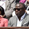 """"""" Basile Boli - People dans les tribunes lors du tournoi de tennis de Roland Garros à Paris le 29 mai 2015. """""""