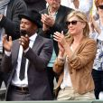 """"""" Sylvain Wiltord et Michèle Laroque - People dans les tribunes lors du tournoi de tennis de Roland Garros à Paris le 29 mai 2015. """""""