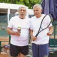 Jean-Pierre Castaldi et Patrick Poivre d'Arvor lors de la deuxième journée du Trophée des personnalités à Roland-Garros, le mercredi 3 juin 2015.