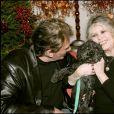 Johnny Hallyday et Brigitte Bardot lors du Noel des animaux à Levallois Perret, le 18 décembre 2004