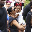 Kim Kardashian, enceinte, et sa fille North assistent à l'anniversaire de Penelope Disick (3 ans) au parc d'attractions Disneyland. Anaheim, le 8 juillet 2015.