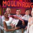Exclusif - Marie-José Pérec avec des artistes du Moulin Rouge à Paris le 21 juillet 2015.