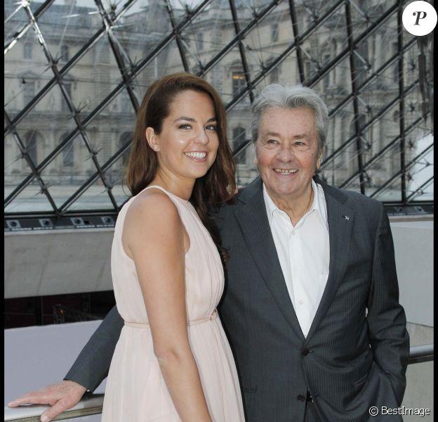 Alain Delon et sa fille Anouchka - Défilé de la collection Salvatore Ferragamo le 12 juin 2012 à Paris