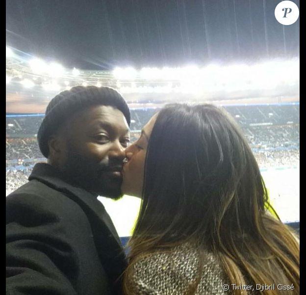 Djibril Cissé et sa compagne Marie-Cécile au Stade de France le 13 novembre 2015 à Saint-Denis, le soir des attentats qui ont ensanglanté Paris et sa banlieue, provoquant la mort de 129 personnes - Photo publiée le 16 novembre 2015