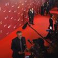 Christophe Lambert (en bas), Jean-Hugues Anglade et sa compagne qui posent, aux César 2016.