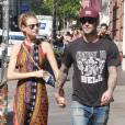 Adam Levine et Behati Prinsloo à New York le 5 septembre 2014. Le couple attend pour l'automne 2016 son premier enfant.