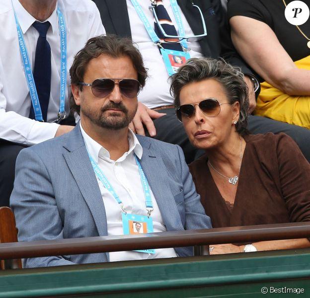 Henri Leconte et sa compagne Maria - People dans les tribunes lors du Tournoi de Roland-Garros (les Internationaux de France de tennis) à Paris, le 27 mai 2016. © Cyril Moreau/Bestimage