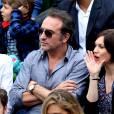 Jean Dujardin et sa compagne Nathalie Péchalat dans les tribunes de la finale homme des internationaux de France de Roland-Garros à Paris le 5 juin 2016. Moreau-Jacovides / Bestimage