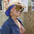 La chanteuse Lââm lors de la Journée mondiale des oubliés des vacances de l'association du Secours populaire sur le Champ-de-Mars à Paris, le 19 août 2015.