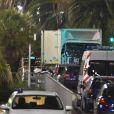 Attentat de Nice: Les officiers de la police judiciaire enquêtent autour du camion criblé de balles qui a tué plus de 80 personnes sur la promenade des anglais à Nice le 15 juillet 2016. Dès la fin du feu d'artifice du 14 Juillet, un homme au volant d'un camion blanc a foncé dans la foule sur près de 2 kilomètres. © Bruno Bebert / Bestimage
