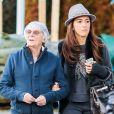 Exclusif - Bernie Ecclestone se promène avec sa femme Fabiana Flosi et des amis dans les rues de Gstaad pendant leurs vacances. Le 22 décembre 2014