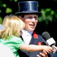 Mia Tindall, dans les bras de sa maman Zara Phillips, essaye d'attraper le micro d'une journaliste au British Festival of Eventing à Gatcombe Park le 6 août 2016. Photo by Chas Breton/Barcroft Images/ABACAPRESS.COM
