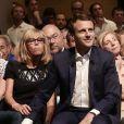 """Emmanuel Macron et sa femme Brigitte Trogneux et Gérard Collomb durant le premier meeting du rassemblement """"En Marche"""" à la Mutualité à Paris, France, le 12 juillet 2016. © Stéphane Lemouton/BestImage"""