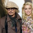 "Johnny Depp et Amber Heard au photocall du film ""Rhum Express"" à Paris le 8 novembre 2011."