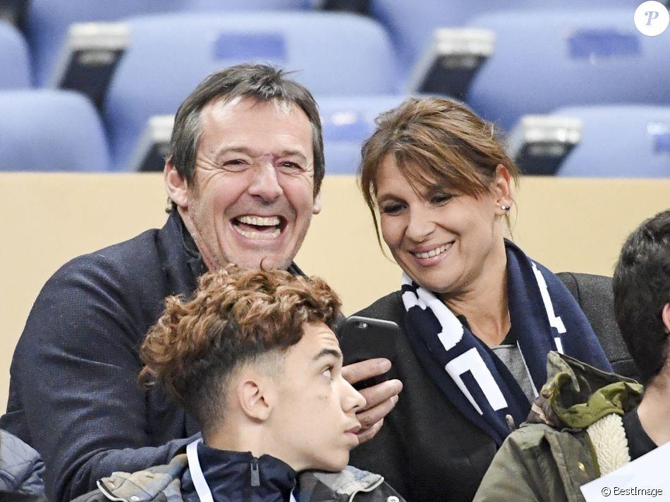 jean luc reichmann et sa femme nathalie au match de qualification pour la coupe du