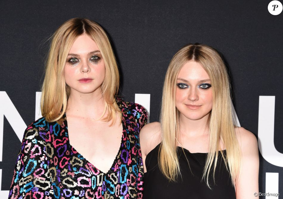 Elle Fanning et sa soeur Dakota Fanning - People au défilé Saint-Laurent à Hollywood le 10 février 2016.
