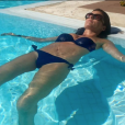Faustine Bollaert en vacances, s'exhibe en bikini le 25 juillet 2016.