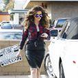 """Khloe Kardashian sur le tournage de son émission de télé-réalité """"Kourtney & Khloe Take The Hamptons"""" à Calabasas, le 15 décembre 2014."""