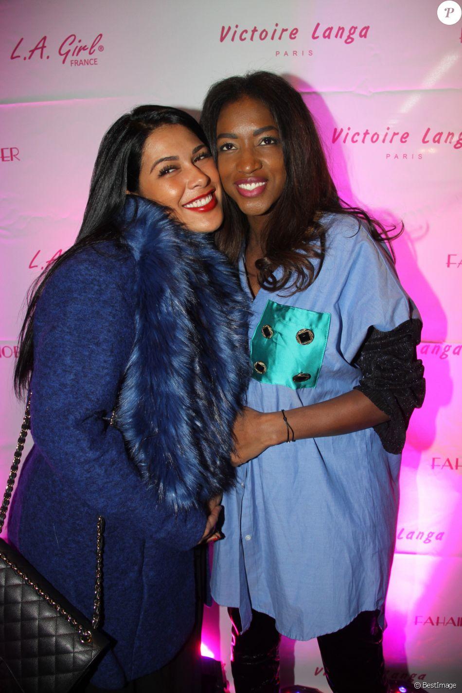 """Ayem Nour (présentatrice Mad Mag NRJ12 TV) et Hapsatou Sy lors de la soirée de lancement des produits cosmétiques """"L.A. Girl Paris"""" au 32 rue Faubourg Saint-Martin à Paris, France, le 26 novembre 2016. © Baldini"""