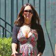 Exclusif - Megan Fox, enceinte de son troisième enfant, se promène avec Brian Austin Green le 12 avril 2016 à Santa Monica.
