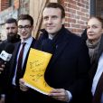 "Emmanuel Macron, leader du mouvement "" En Marche "", candidat à l'élection présidentielle reçoit une botte dédicacée en cadeau dans une exploitation agricole ""Les Buissons"" specialisée dans la micro-méthanisation en compagnie de Laurence Haïm, la porte-parole du mouvement ""En Marche"" à Saint-Lambert-La-Potherie, France, le 28 Fevrier 2017. © Patrick Bernard/Bestimage  Emmanuel Macron, ""En Marche"" movement candidate for the French presidential election, visits a farm with a micro anaerobic digestion facility in Saint-Lambert-La-Potherie, France on February 28, 2017.28/02/2017 - Saint-Lambert-La-Potherie"