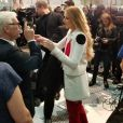 Le journaliste Robin Leach a posté une photo de Céline Dion (avec son frère Michel) présentant sa collection pour Bugatti à Las Vegas, le 21 février 2017