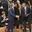 Laura Bush, l'ex-président George Bush, Michelle Obama et Barack Obama assistent à une cérémonie d'hommage pour des policiers morts à Dallas, le 12 juillet 2016