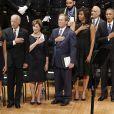 Laura Bush, George Bush, Michelle Obama et Barack Obama assistent à une cérémonie d'hommage pour des policiers morts à Dallas, le 12 juillet 2016