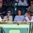 Bob Sinclar, sa femme Ingrid et Mirka (Miroslava) Vavrinec-Federer dans les tribunes lors du Master 1000 de Miami à Key Biscayne, Floride, Etats-Unis, le 27 mars 2017.