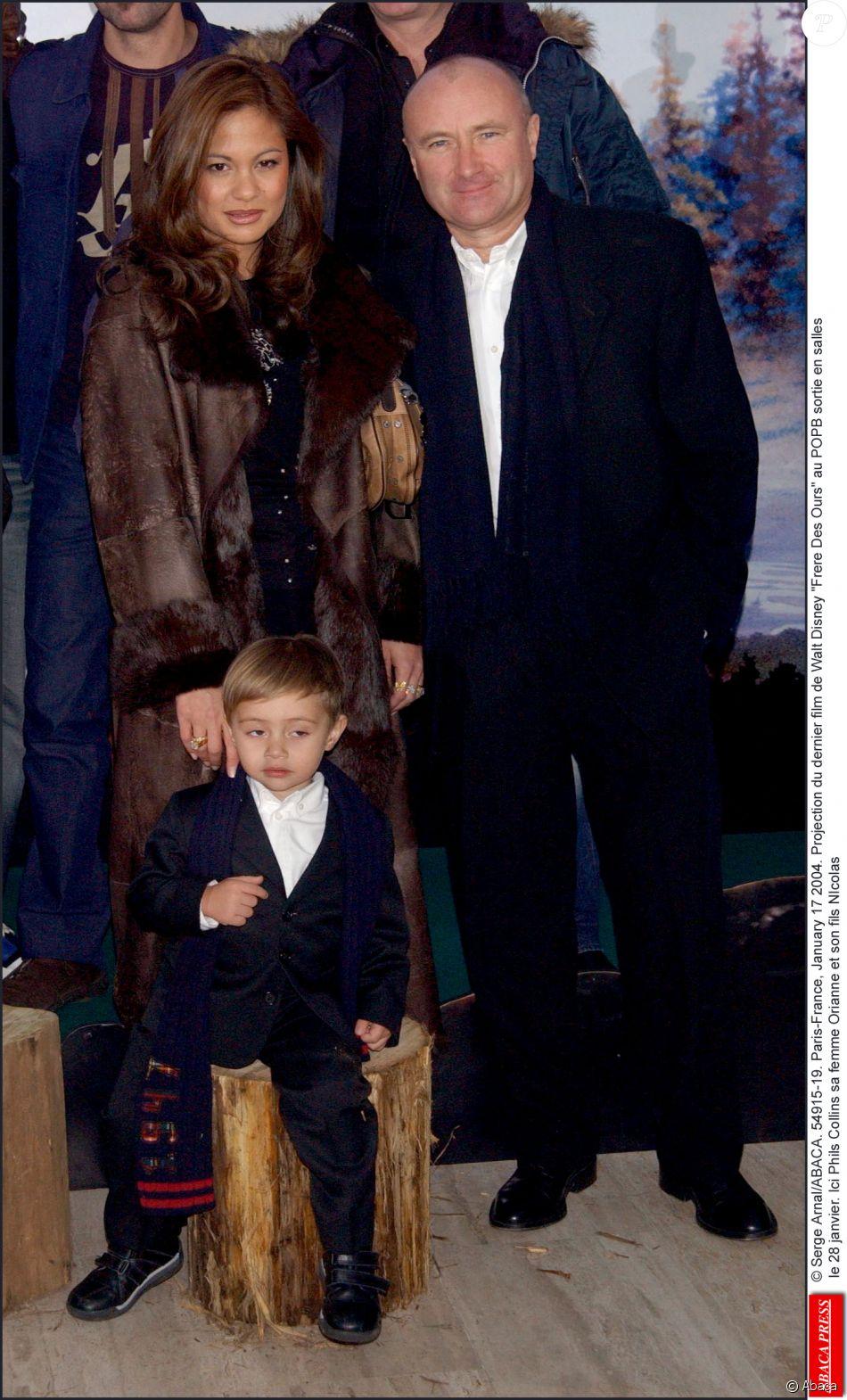 Phil Collins sa femme Orianne et son fils Nicolas lors de la Projection du dernier film de Walt Disney Frere Des Ours au POPB, le 17 janvier 2004 © Serge Arnal