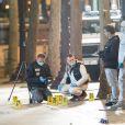 Les équipes de l'identité judiciaire inspectent les lieux de l'attaque, le car de police pris pour cible et la voiture du terroriste. Le terroriste a été abattu après avoir ouvert le feu sur un véhicule de police, faisant 1 mort et 2 bléssés chez les policiers et blessant également un passant. L'attaque a peu de temps après été revendiquée par le groupe terroriste Etat Islamique (EI, Daech). Paris, le 20 avril 2017.