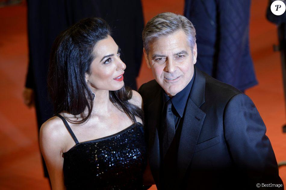 """George Clooney et sa femme Amal Alamuddin Clooney - Tapis rouge du film """"Hail Caesar!"""" lors du 66e Festival International du Film de Berlin, la Berlinale, le 11 février 2016."""