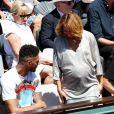 Tony Yoka et sa compagne Estelle Mossely (enceinte) - Personnalités dans les tribunes lors des internationaux de France de Roland Garros à Paris. Le 10 juin 2017. © Jacovides - Moreau / Bestimage