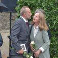 Antoine Duléry et Françoise Vidal (femme de Jean Rochefort) lors des obsèques de Claude Rich en l'église Saint-Pierre-Saint-Paul d'Orgeval à Orgeval le 26 juillet 2017.26/07/2017 - Orgeval