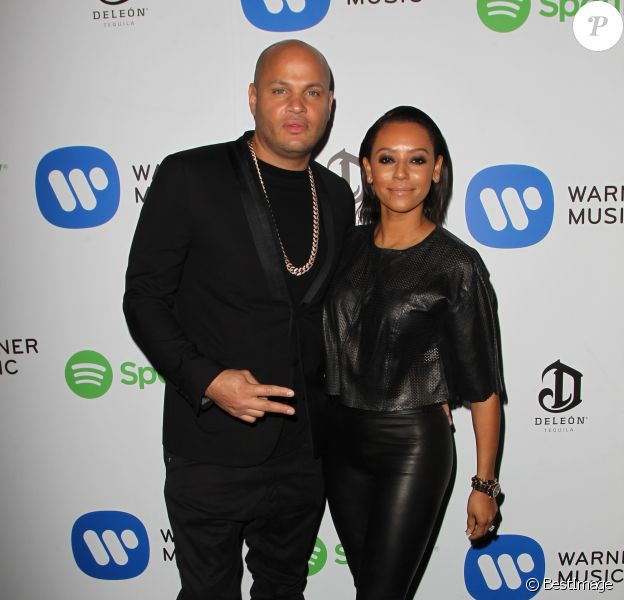 Melanie Brown (Mel B) et son mari Stephen Belafonte à la Soirée de Warner Music Group lors des Grammy Awards au Chateau Marmont à Los Angeles, le 8 février 2015.